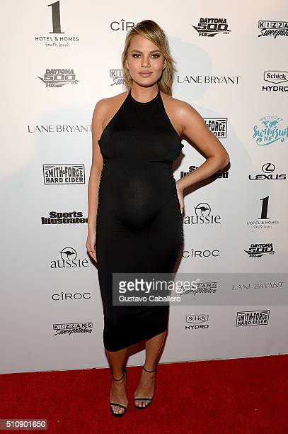 Model Chrissy Teigen attends the Sports Illustrated Swimsuit 2016 Swim BBQ VIP at 1 Hotel Homes South Beach on February 17 2016 in Miami Beach Florida