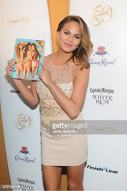 Model Chrissy Teigen attends the Sports Illustrated Swimsuit 50 Years of Swim in NYC Celebration at the Sports Illustrated Swimsuit Beach House on...
