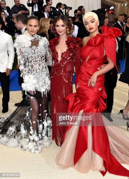 Model Chrissy Teigen designer Georgina Chapman and singer Rita Ora attend 'Rei Kawakubo/Comme des Garcons Art Of The InBetween' Costume Institute...