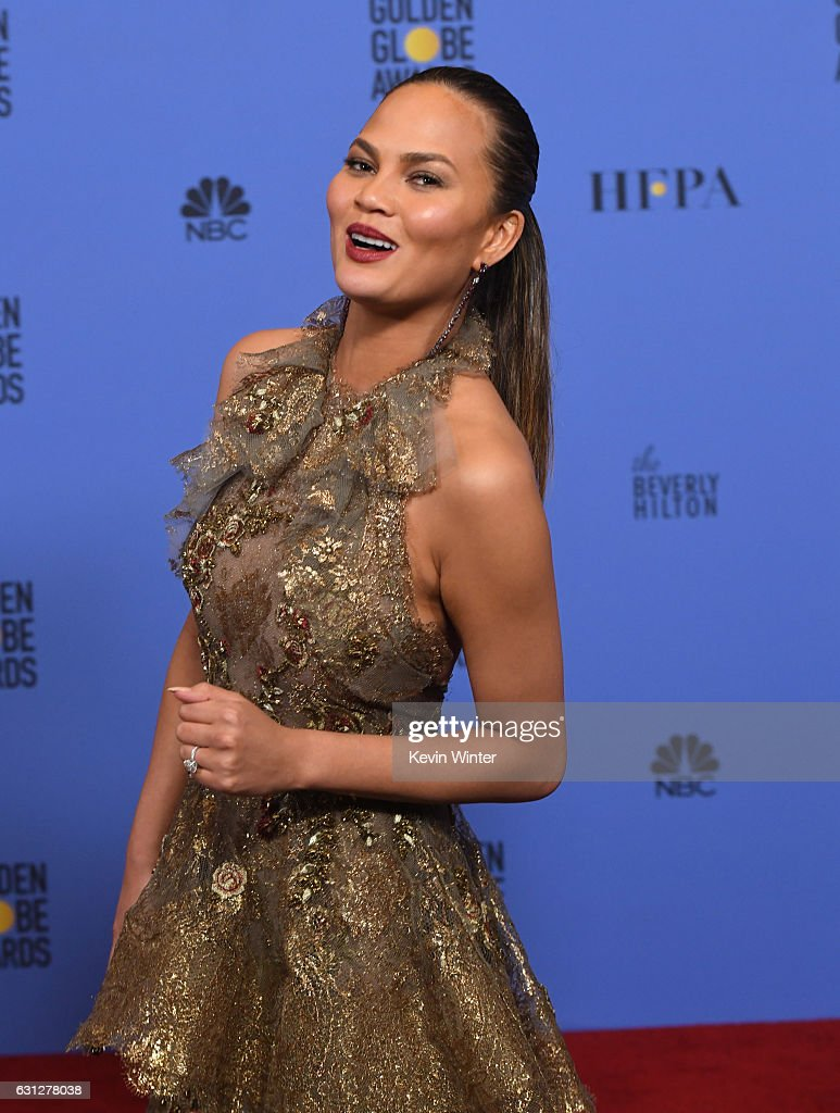 Model Chrissy Teigen poses in the press room during the 74th Annual Golden Globe Awards at The Beverly Hilton Hotel on January 8, 2017 in Beverly Hills, California.