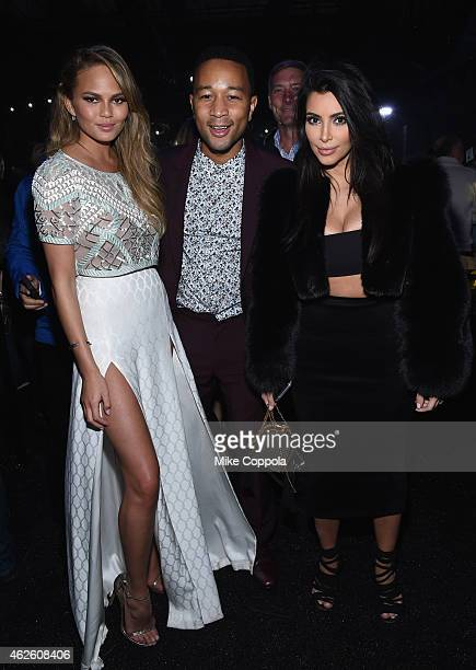 Model Chrissy Teigen recording artist John Legend and TV personality Kim Kardashian attend DirecTV Super Saturday Night hosted by Mark Cuban's AXS TV...