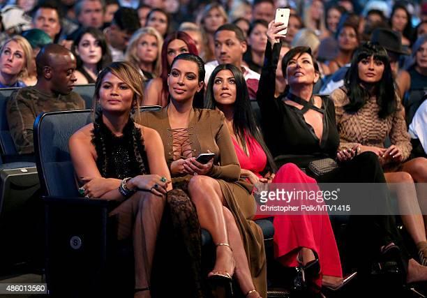 Model Chrissy Teigen TV personalities Kim Kardashian Kourtney Kardashian Kris Jenner and Kylie Jenner attend the 2015 MTV Video Music Awards at...