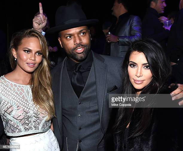 Model Chrissy Teigen TV personality AJ Calloway and TV personality Kim Kardashian attend DirecTV Super Saturday Night hosted by Mark Cuban's AXS TV...