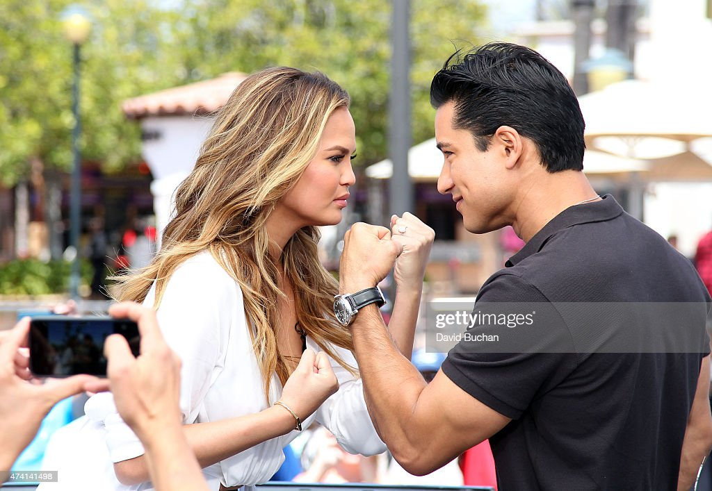 Model Chrissy Teigen (L) visits Mario Lopez on the set of 'Extra' at Universal Studios Hollywood on May 20, 2015 in Universal City, California.