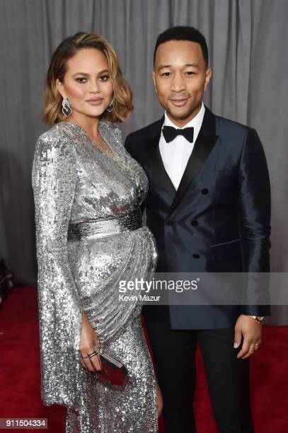 Model Chrissy Tiegan and recording artist John Legend attend the 60th Annual GRAMMY Awards at Madison Square Garden on January 28 2018 in New York...