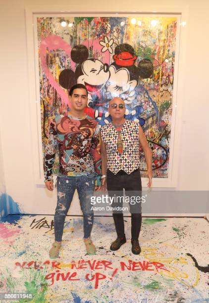 Model Christian J Perez and Art Dealer Poet Jimmy D Robinson attend Art Miami VIP Kickoff at Art Miami Pavilion on December 5 2017 in Miami Florida