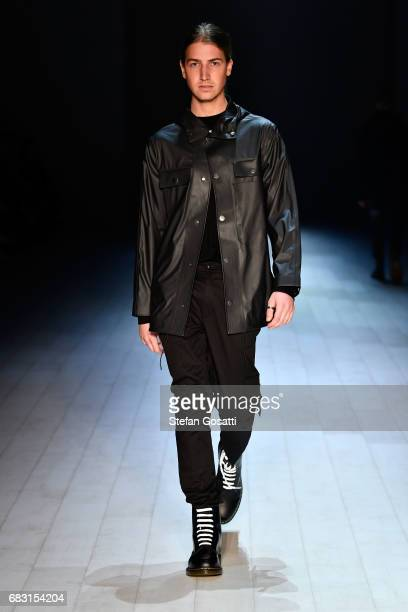 Model Christian Wilkins walks the runway during the Justin Cassin show at MercedesBenz Fashion Week Resort 18 Collections at Carriageworks on May 15...