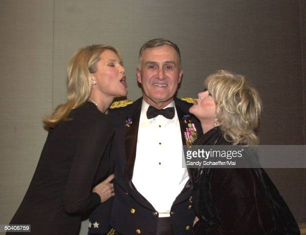 Model Christie Brinkley and actress Connie Stevens cuddling up to Chrmn of Joint Chiefs of Staff Gen Hugh Shelton at USO awards dinner at which...
