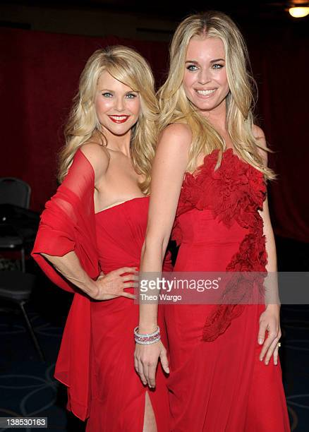 Model Christie Brinkley and actress Rebecca Romijn prepare backstage at The Heart Truth's Red Dress Collection 2012 Fashion Show at Hammerstein...