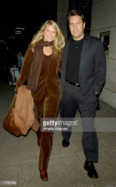 Model Christie Brinkley and husband Peter Cook leave a store on Madison Avenue January 9 2003 in New York City