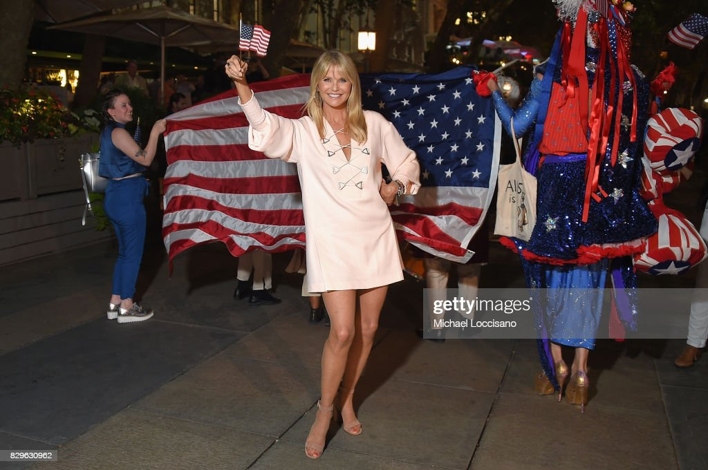 Model Christie Brinkley joins a procession from the theater to the after party as award-winning filmmaker Michael Moore celebrates his Broadway Opening Night in 'The Terms of My Surrender' at Belasco Theatre on August 10, 2017 in New York City.