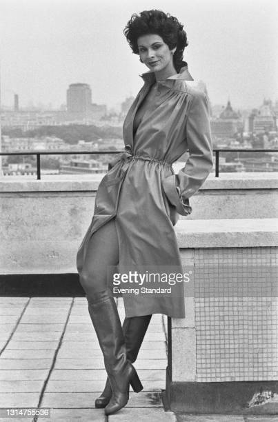 Model Christina wearing knee boots and a dress with buttons up the front, UK, 30th July 1974.