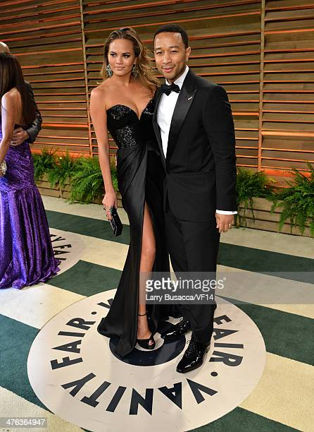 Model Christine Teigen and musician John Legend attend the 2014 Vanity Fair Oscar Party Hosted By Graydon Carter on March 2 2014 in West Hollywood...