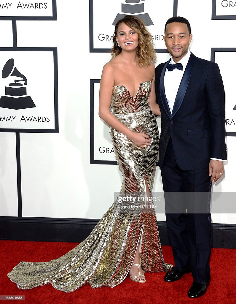 Model Christine Teigen and musician John Legend attend the 56th GRAMMY Awards at Staples Center on January 26, 2014 in Los Angeles, California.