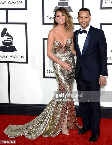 Model Christine Teigen and musician John Legend attend the 56th GRAMMY Awards at Staples Center on January 26 2014 in Los Angeles California