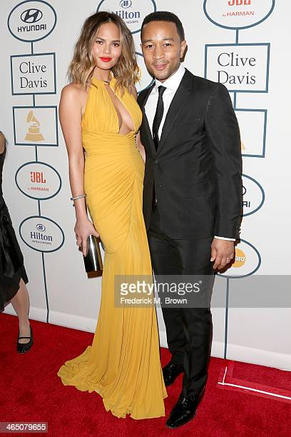 Model Christine Teigen and recording artist John Legend attend the 56th annual GRAMMY Awards PreGRAMMY Gala and Salute to Industry Icons honoring...