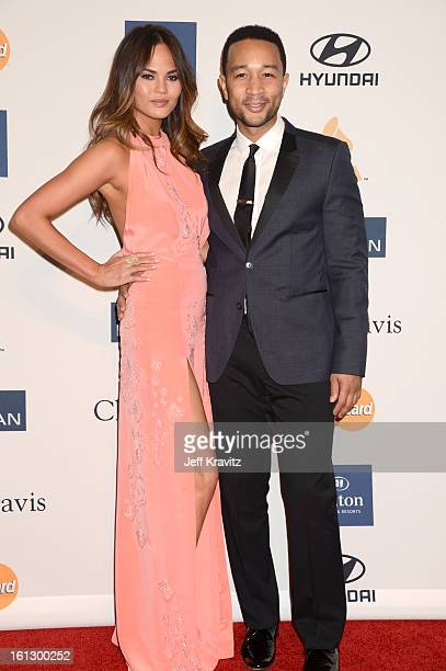 Model Christine Teigen and singer John Legend arrive at Clive Davis and The Recording Academy's 2013 GRAMMY Salute to Industry Icons Gala held at The...