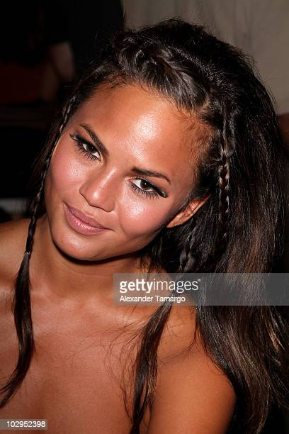 Model Christine Teigen poses backstage at the True Religion Swimwear 2011 fashion show during MercedesBenz Fashion Week Swim at the Raleigh on July...