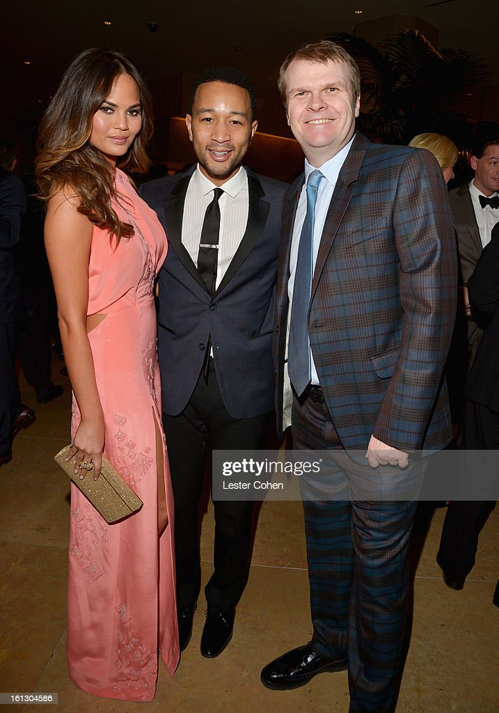 Model Christine Teigen, singer John Legend and Chairman/CEO of Columbia Records Rob Stringer arrive at the 55th Annual GRAMMY Awards Pre-GRAMMY Gala and Salute to Industry Icons honoring L.A. Reid held at The Beverly Hilton on February 9, 2013 in Los Angeles, California.