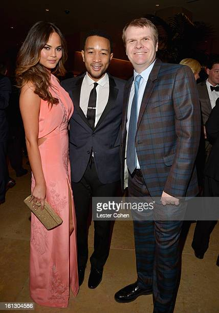 Model Christine Teigen singer John Legend and Chairman/CEO of Columbia Records Rob Stringer arrive at the 55th Annual GRAMMY Awards PreGRAMMY Gala...