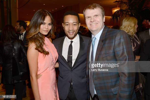 Model Christine Teigen singer John Legend and Columbia Chairman/CEO Rob Stringer arrive at the 55th Annual GRAMMY Awards PreGRAMMY Gala and Salute to...