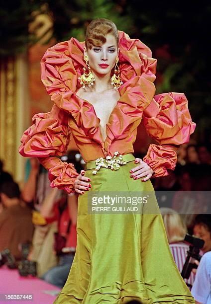 US model Christy Turlington displays a 'Bisk' shot taffeta bolero with a ruffled collar and sleeves over a midlength lichen green shot taffeta bell...