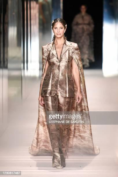 Model Christy Turlington presents a creation of British designer Kim Jones for the Fendi's Spring-Summer 2021 collection during the Paris Haute...