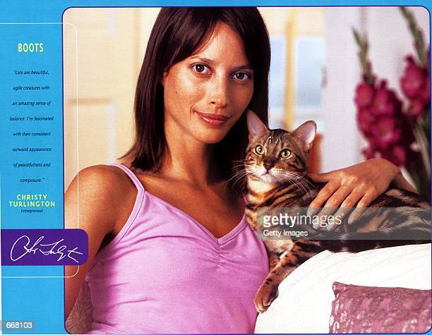 Model Christy Turlington with her cat Boots were one of the many celebrities to pose for the Purina 2001 Cat Chow Celebrity Cat Calendar sponsored by...