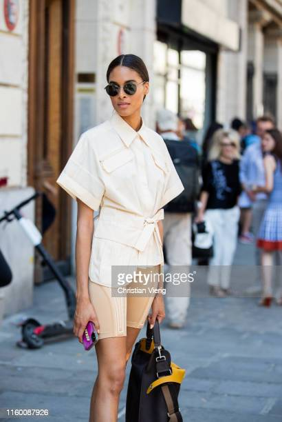 Model Cindy Bruna is seen wearing beige cylce pants, knotted button shirt outside Jean Paul Gaultier during Paris Fashion Week - Haute Couture...