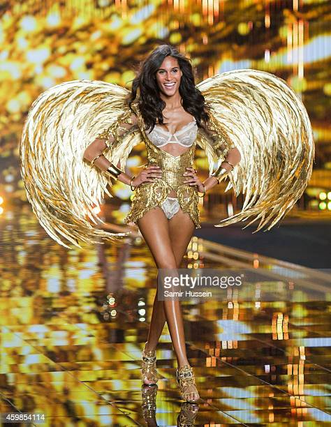 Model Cindy Bruna walks the runway at the annual Victoria's Secret fashion show at Earls Court on December 2 2014 in London England