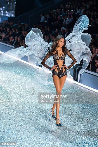 Model Cindy Bruna walks the runway during the 2016 Victoria's Secret Fashion Show at Le Grand Palais in Paris on November 30 2016 in Paris France