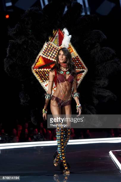 Model Cindy Bruna walks the runway during the 2017 Victoria's Secret Fashion Show In Shanghai at MercedesBenz Arena on November 20 2017 in Shanghai...