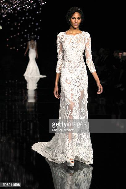Model Cindy Bruna walks the runway for Pronovias bridal collection during the 'Barcelona Bridal Fashion Week 2016' at Italian Pavilion of Fira...