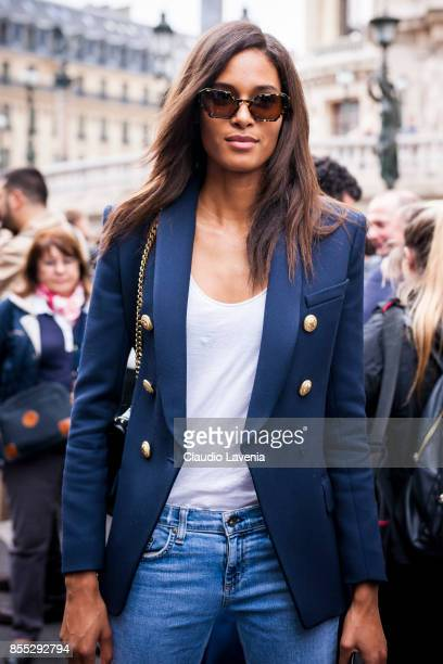 Model Cindy Bruna wearing denim jeans ankle boots blazer and white tshirt is seen after the Balmain fashion show during Paris Fashion week Womenswear...