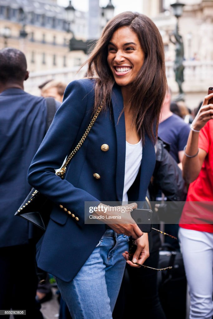 Model Cindy Bruna wearing denim jeans, ankle boots, blazer and white tshirt is seen after the Balmain fashion show during Paris Fashion week Womenswear SS18 on September 28, 2017 in Paris, France.