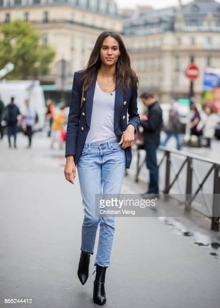 Model Cindy Bruna wearing denim jeans ankle boots blazer white tshirt is seen outside Balmain during Paris Fashion Week Spring/Summer 2018 on...