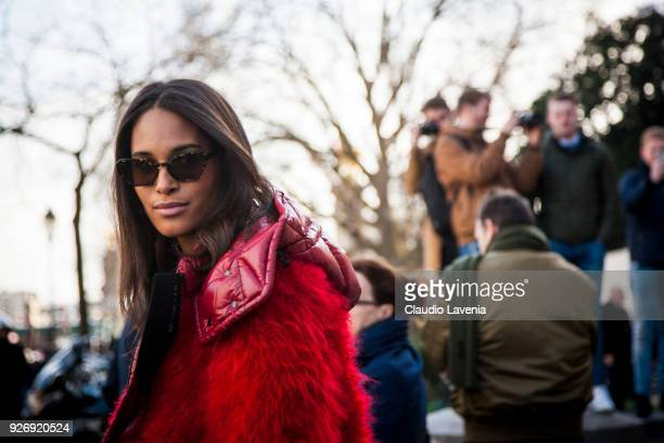 Model Cindy Bruna wearing Moncler red winter coat and black tshirt is seen in the streets of Paris after the Elie Saab show during Paris Fashion Week...