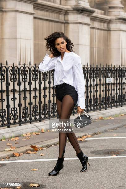 Model Cindy Bruna wears all Y-Project with a Delvaux bag on September 26, 2019 in Paris, France.