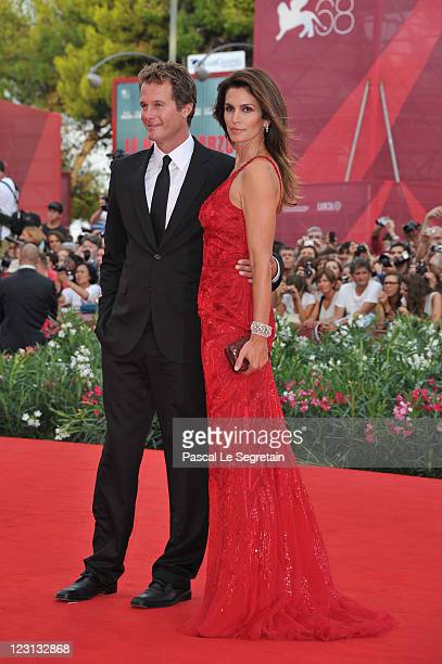 Model Cindy Crawford and husband Rande Gerber attend The Ides Of March premiere during the 68th Venice Film Festival at the Palazzo del Cinema on...