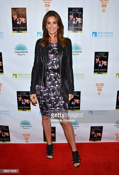 Model Cindy Crawford arrives at the Enter Miss Thang book launch party at Cafe Habana on October 21 2013 in Malibu California