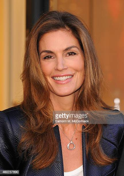 Model Cindy Crawford attends a photocall to launch the OMEGA Oxford Street Boutique at OMEGA Boutique Oxford Street on December 10 2014 in London...