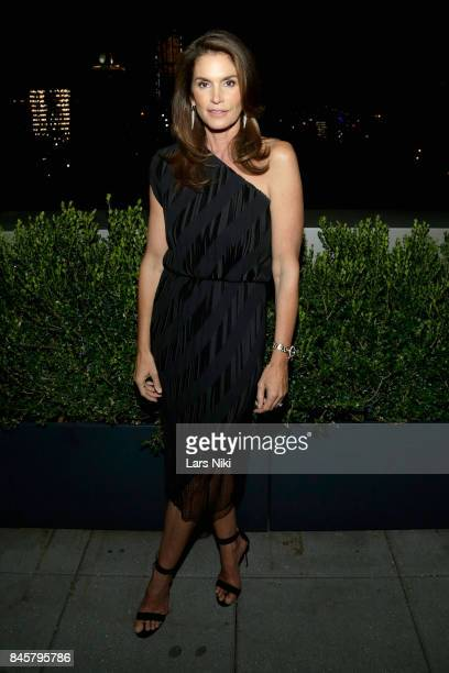 Model Cindy Crawford attends the fashion week celebration with DuJour Magazine hosted by Cindy Crawford and Rande Gerber at Mr Purple on September 11...