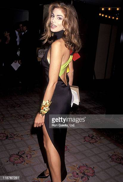 e89aea149ac Model Cindy Crawford attends the Fifth Annual California Industry Friends  of AIDS Project Los Angeles Fashion. Gianni Versace Retrospective ...