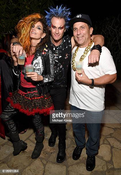 Model Cindy Crawford Casamigos cofounder Rande Gerber and Discovery Land Company CEO Mike Meldman attend the Casamigos Halloween Party at a private...