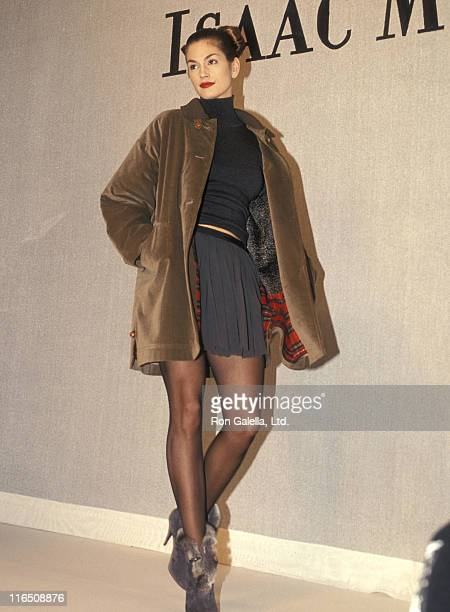 Model Cindy Crawford walks the runway at the Fall 1994 Fashion Week Isaac Mizrahi Fashion Show on April 12 1994 at Bryant Park in New York City