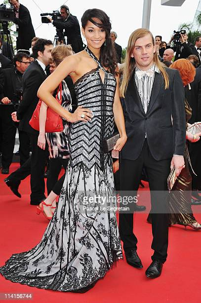 Model Cindy Fabre and Christophe Guillarme attends the 'Habemus Papam' premiere at the Palais des Festivals during the 64th Cannes Film Festival on...