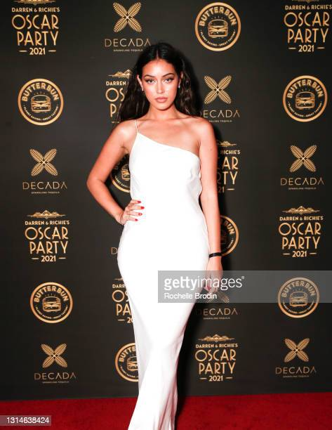 Model Cindy Kimberly poses on the red carpet at Darren Dzienciol & Richie Akiva's Oscar Party 2021 on April 25, 2021 in Bel Air, California.