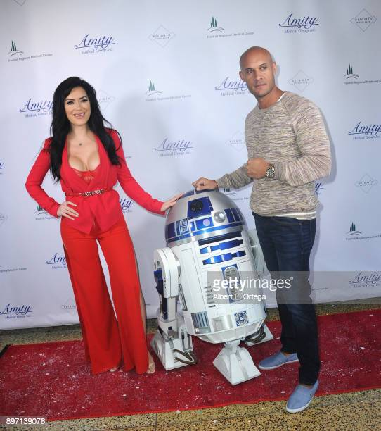 Model CJ Sparxx poses with fighter Steve Orosco and R2D2 at A Children's Miracle Holiday Sponsored by Amity Medical Group and Vitamin Patch Club in...