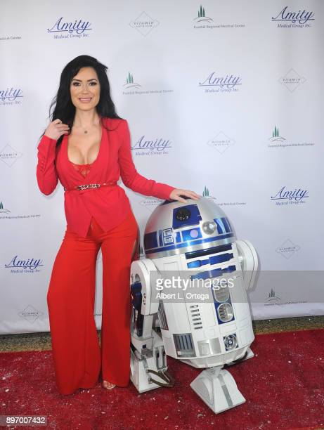 Model CJ Sparxx poses with R2D2 at A Children's Miracle Holiday Sponsored by Amity Medical Group and Vitamin Patch Club in Partnership with Foothill...