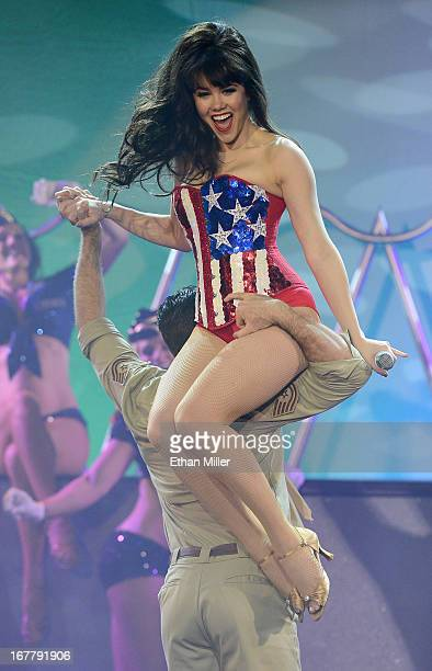 Model Claire Sinclair performs as she rides on the shoulders of dancer Ryan Kelsey during the premiere of the show Pin Up at the Stratosphere Casino...